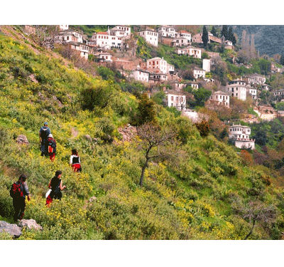 Hiking on the side of mountain Pelion approaching a village