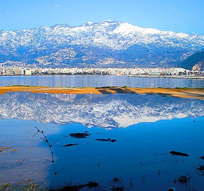 View of Volos and Snowy Mountain Pelion on a sunny day